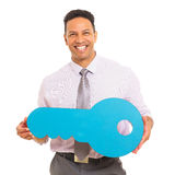 Man holding paper key Royalty Free Stock Photography