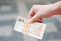 Man holding paper money (czech koruna) Royalty Free Stock Photos