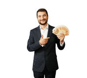 Man holding paper money and pointing. Successful young businessman holding paper money and pointing. isolated on white background Royalty Free Stock Photo