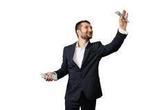Man holding paper money. Smiley businessman holding paper money over white background Stock Photos