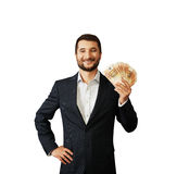 Man holding paper money. Successful young businessman holding paper money and smiling. isolated on white background Stock Images