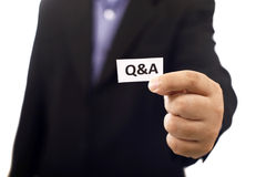 Man Holding Paper With Q&A Text Royalty Free Stock Image
