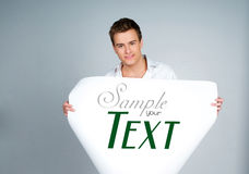 Man holding a paper with sample text Stock Photo
