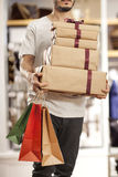 Man holding paper shopping bag with gift boxes Royalty Free Stock Photography