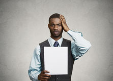 Man holding paper, statement, shocked with bad news Royalty Free Stock Image