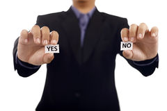 Man Holding Paper With Yes And No Text Stock Photo