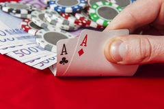 Man holding pair of aces Royalty Free Stock Image