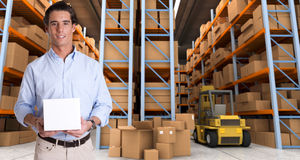 Man holding parcel in warehouse b Stock Image
