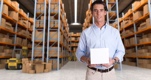 Man holding parcel in warehouse a Royalty Free Stock Images