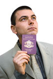 Man holding passport looking up Stock Images