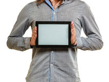 Man holding pc tablet. Blank screen copyspace. Royalty Free Stock Images