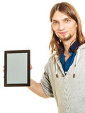 Man holding pc tablet. Blank screen copyspace. Royalty Free Stock Photos