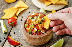 Man holding peach salsa Stock Photo