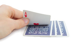 Man holding and peeking a playing card (ace of hearts) Stock Photography