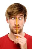 Man holding pencil between his eyes Stock Photo