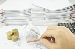 Man holding pencil horizon over balance sheet Stock Images