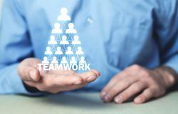 Man holding people icon. Human Resources and Teamwork. Business. Concept Stock Photos