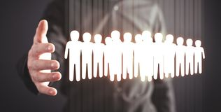 Man holding people icons. Business concept stock image