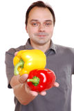 Man holding peppers Stock Photos