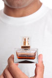 Man holding perfume aftershave Royalty Free Stock Image