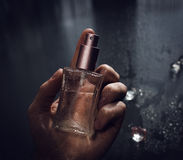 Man holding perfume Stock Photo