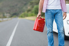 Man holding petrolcan Stock Photos