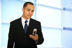 Man Holding Phone And Smile In Office Stock Images