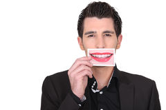 Man holding a photo of lips stock photo