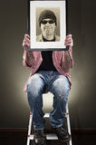 Man holding picture frame Stock Photo