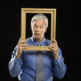 Man holding picture frame. Stock Photos