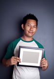 Man holding picture frame Stock Photos