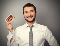 Man holding picture with yellow teeth Stock Photo