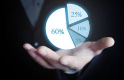 Man holding pie graph. Business concept stock photos