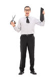 Man holding a piece of his tie and scissors Stock Photos