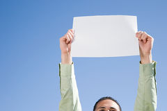 Man holding piece of paper Royalty Free Stock Images
