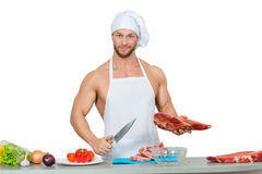 Man holding a piece of raw meat. Royalty Free Stock Photography