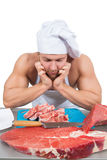 Man holding a piece of raw meat. Stock Photo
