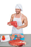Man holding a piece of raw meat. Stock Images
