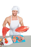 Man holding a piece of raw meat. Royalty Free Stock Photos