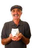 Man holding piggy bank Royalty Free Stock Image