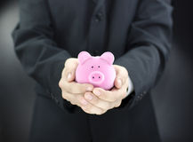 Man holding piggy bank Stock Photos