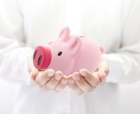 Man holding piggy bank royalty free stock images