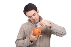 Man holding a piggy bank Stock Photo