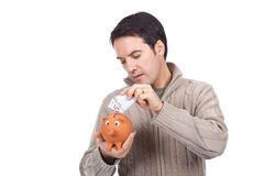 Man holding a piggy bank Royalty Free Stock Images