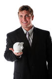 Man Holding a Piggy Bank Stock Photos