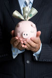 Man Holding Piggy Bank Royalty Free Stock Photos