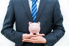 Man holding piggy bank -- the concept of saving royalty free stock images