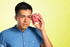 Man holding a piggy bank Royalty Free Stock Image