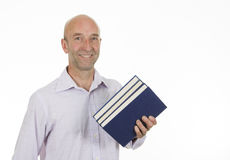 Man holding a pile of books Stock Photos