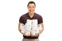 Man holding a pile of toilet paper rolls Royalty Free Stock Photo